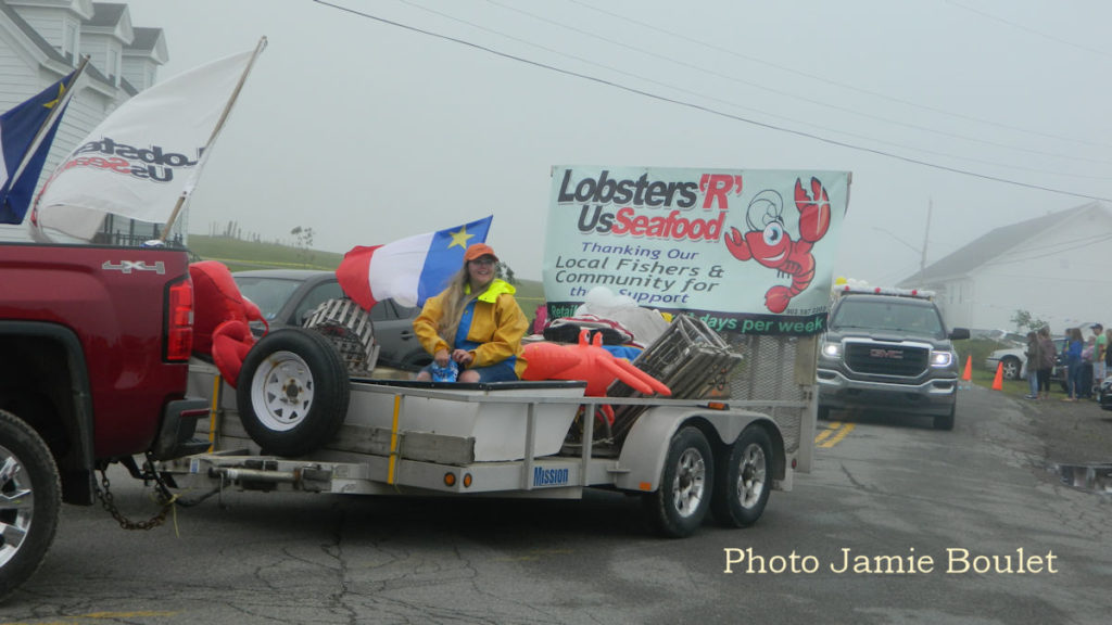 Jamie Boulet Remembering 2018 The Lobsters R us Float on the Parade of Floats during the Acadian festival