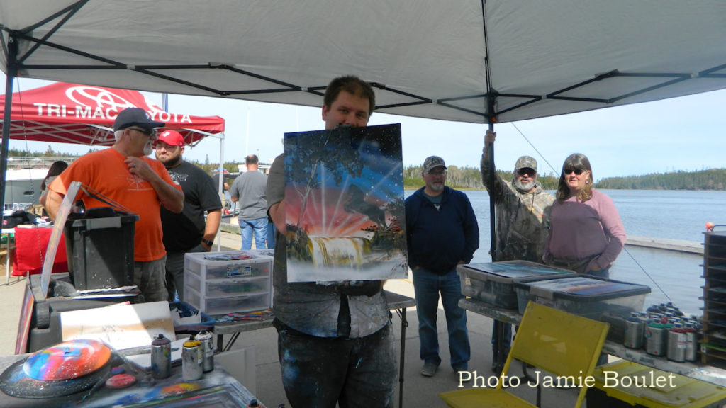 A collection by Jamie Boulet - Nathan Salmon with his spray painting during the St. Peter's Pirate Days